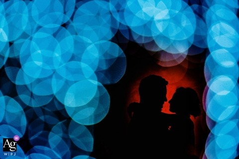 El Convento de Blanes Wedding Portraits - Red and blue bokeh silhouette
