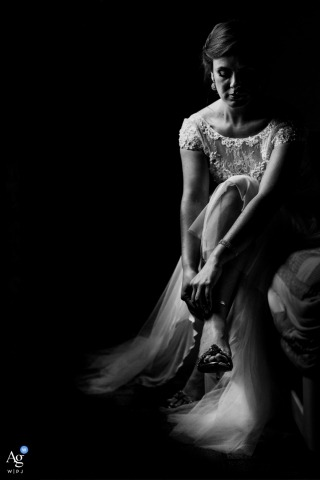 Rio Grande du Sol wedding photographer froze the moment in this black and white image of the bride strapping on her shoes before the ceremony