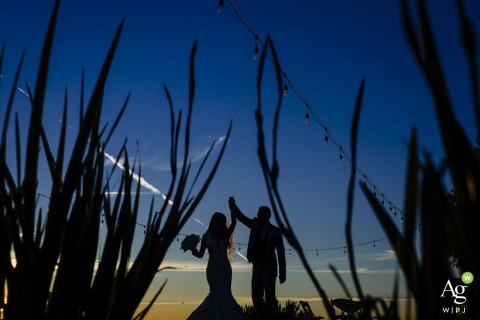 stonebrae country club wedding venue photo of the couple dancing at sunset against the blue sky