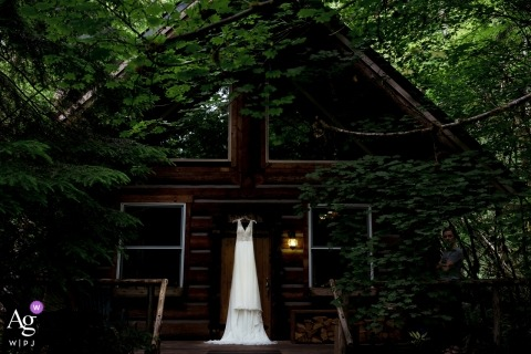 Wellspring Spa Photo of Wedding Dress hanging from log cabin door