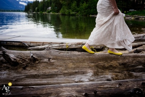 Wedding Photograph of the Bride as she walks along log in yellow falls at the Brown Family Homestead