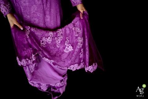 Washington - edgewater hotel wedding venue photo - the bride adjusts purple dress