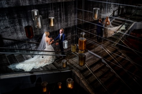 Creative idea for indoor portrait of bride and groom on wedding day.