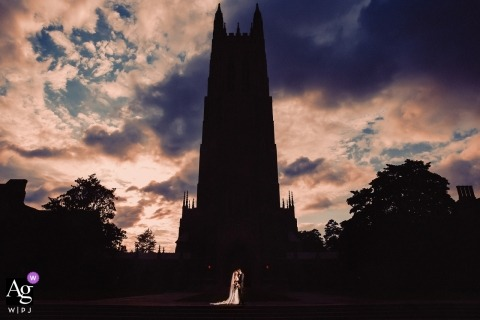 North Carolina wedding portrait of bride and groom outside Duke Chapel, lit by strobe for silhouette of church