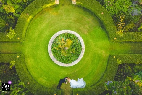 Aerial drone portrait of the bride and groom at the venue gardens commenda di san calogero
