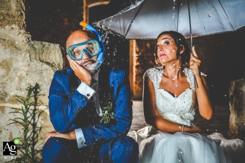 Borgo del Carato - Palazzolo Acreide | Spring in Sicily | Lit portrait of the bride and groom under umbrella with rain