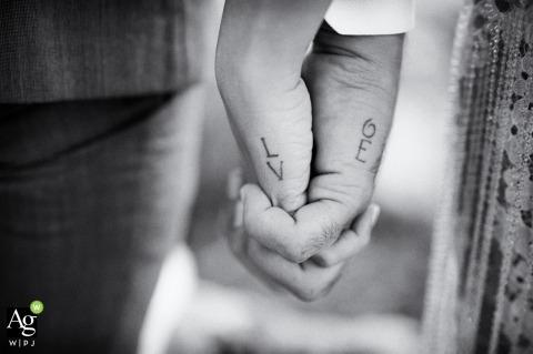 Terracina Italy - Grappolo d'uva ricevimenti - Bride and Groom Hand Detail Photo of LOVE Tattoo
