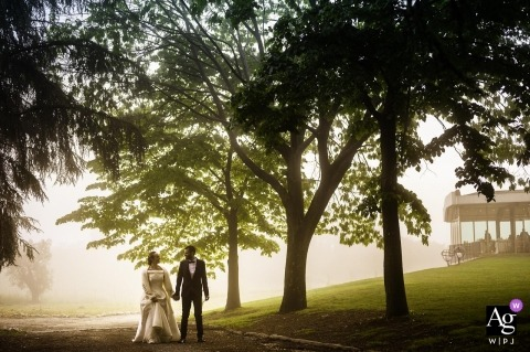 Cincinnato, Cori Italy wedding portrait of the bride and groom walking on the reception grounds on a foggy day
