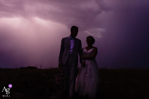 Missouri Headwaters State Park wedding day portrait of couple with an evening sky and lightning