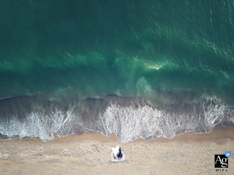 A wedding couple drone portrait from the shoreline of Costa dei Barbari
