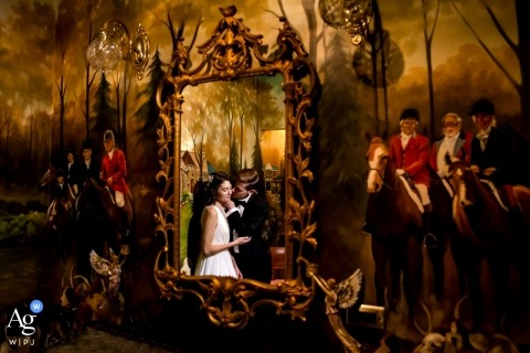 Chicago wedding portrait of the bride and groom in a mirror with a mural around them