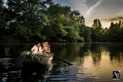 Fort Vechten wedding photograph of the bride and groom taking a ride in a boat.