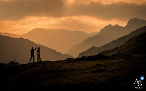 Langdale, Cumbria silhouette portrait of the bride and groom dancing in the mountains