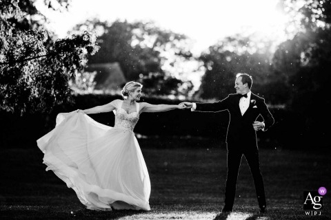 Fawsley Hall, Northamptonshire wedding portrait of a couple dancing in the evening light