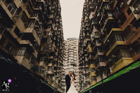 Bride and Groom wedding portrait shot amongst the tall buildings in Hong Kong.