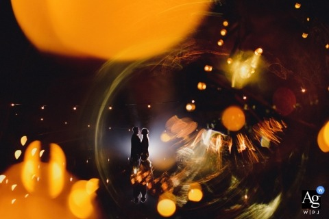 Northbrook Park wedding portrait of a bride and groom shot through a pint glass
