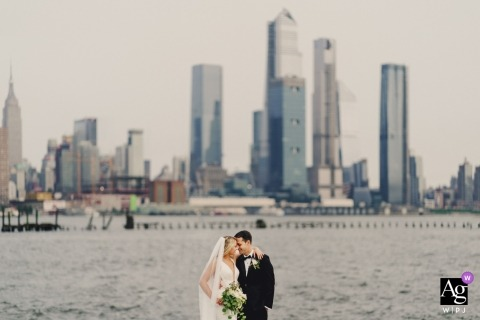 Derbyshire wedding photographers creates an image of a bride and groom with the New York skyline in the background