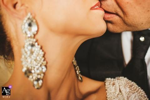 Dominikanski Monastery, Slovenia wedding detail of the bride's earrings, as she is kissed by the groom