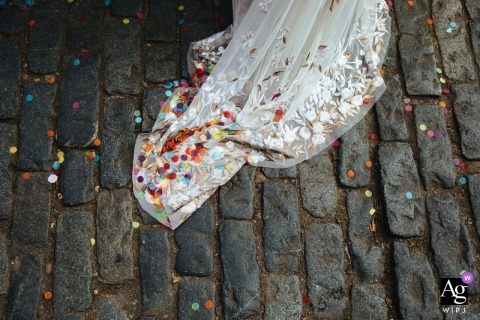 Clapton Country Club, London wedding detail of confetti and dress on old cobble stones