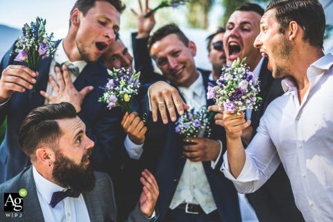 Graz Wedding Photography at the Styria Reception Venue | The groom and groomsmen having a blast with the wedding ring.