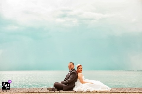 Thessaloniki couple portrait on wedding day on a dock by the sea