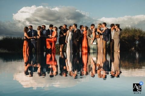 Podere Ferranesi, Crete Senesi wedding group photo of the couples kissing