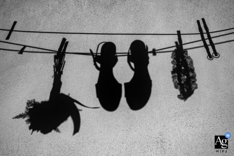 Reggio Calabria wedding detail photo of the bride's shoes, bouquet and garter hanging from a clothesline