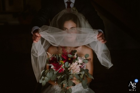 Wedding portrait of the bride as her veil is lifted at Finca Machoenia, Francia