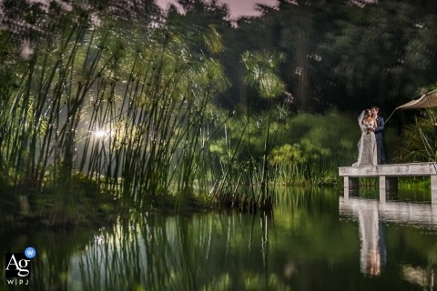 Cieneguilla, Peru wedding image shot as a long exposure of bride and Groom mirroring in a pond