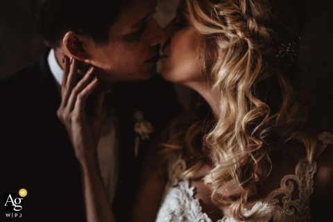 Fattoria La Loggia, Florence artistic wedding day portrait of the bride and groom kissing