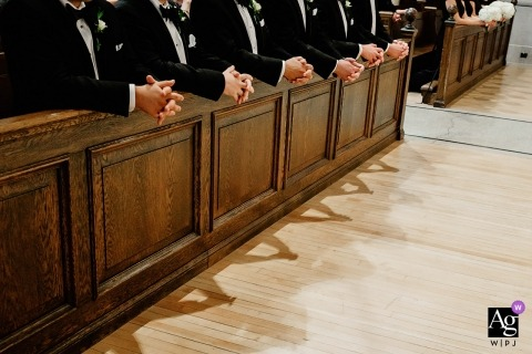 Wedding detail photo of the groomsmen hands at the College of the Holy Cross, Worcester, MA