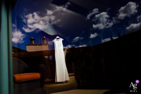 Picture of the bride's dress through a window reflection in Vail, Colorado