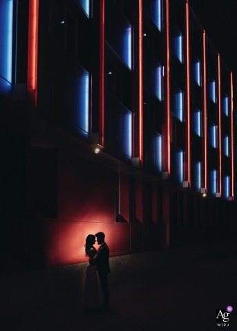 Sofia, Bulgaria	wedding day portrait silhouette of newlyweds spotlighted against a building