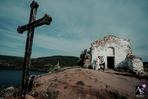 Sofia, Bulgaria	Wedding Day photo session of a bride and groom at a old church with a cross in a cross in the foreground