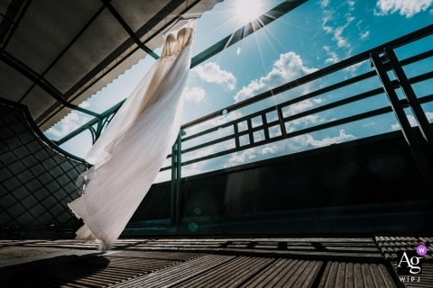 Sofia, Bulgariawedding dress blowing in the wind as it hangs on a lanai