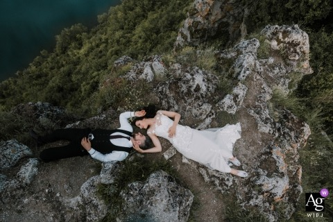 Sofia, Bulgaria	Wedding Day photo session of a couple laying on rocks during their portrait shoot