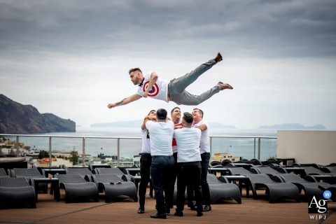 Funchal wedding photographer: The theme of the wedding was super heroes and the groom just had to have a super hero photo.