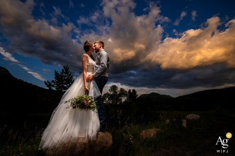 Rocky Mountain National Park. Bride and groom sunset portrait