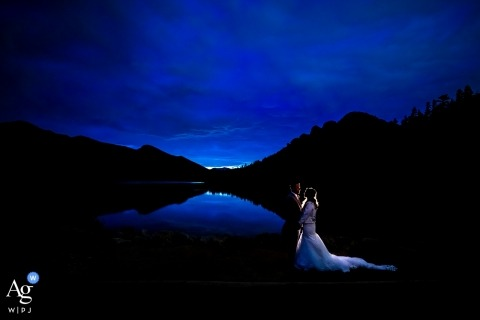 Bride and Groom blue hour portrait by lake. Lily Lake - Rocky Mountain National Park