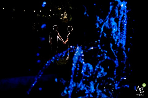 Lionsgate Event Center (Lafayette, CO) wedding venue picture | Portrait of the Bride and groom by fountain at night | OCF Lit Portrait