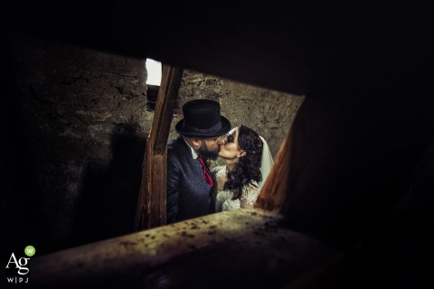 Portofinowedding day photo | Portrait of the groom with his top hat, kissing the bride | you and me