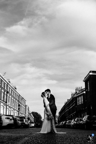 Liverpool wedding portrait of the bride and groom in the soft summer light on the cobbled streets .