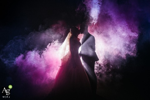 Wishaw County Sports, Birmingham, England wedding venue photo | Creative Night Shot of a Bride and Groom | Purple Smoke Bomb with Lights