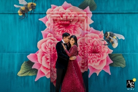 Wedding Photography at the Four Seasons Atanta | Bride & Groom Portrait with flower mural