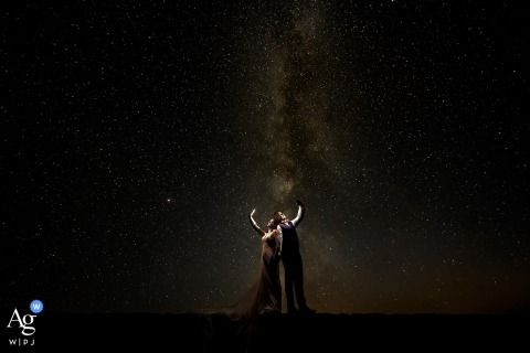 bride and groom portrait under the stars at night in sicily