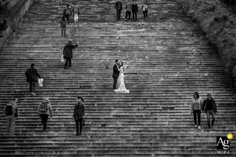 rome bride and groom portrait on wedding day on crowded stairs