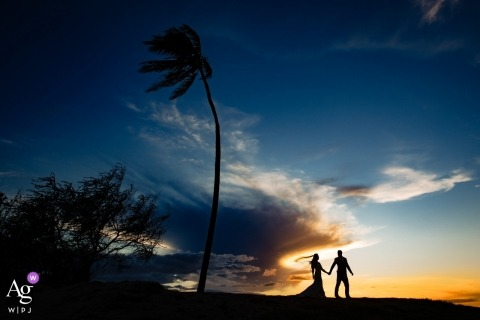 On the beach in Kihei, Maui, Hawaii wedding photographer: When the sunset and the veil line up perfectly...