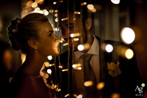 villa bossi varese wedding venue photo - bride and groom with glass and lights