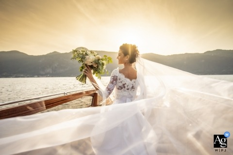 Lecco Lombardy wedding portrait of the bride, her dress and bouquet on Lake Como