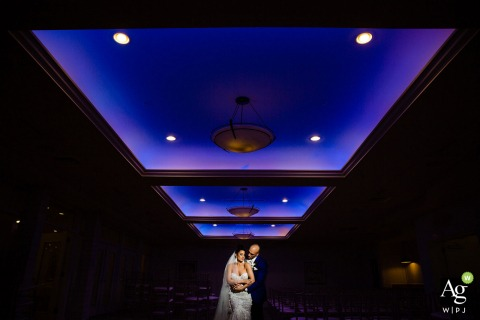 Icona Avalon wedding venue photo | Using the color up top creatively during a portrait session with the bride and groom